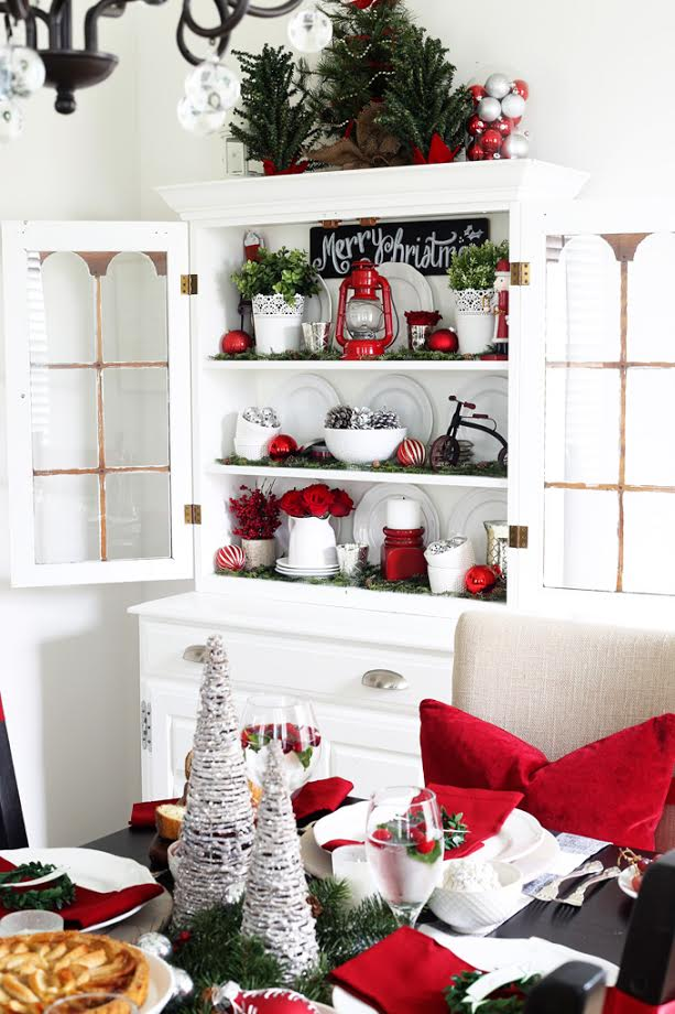 Open shelves with red and white decorations on it.