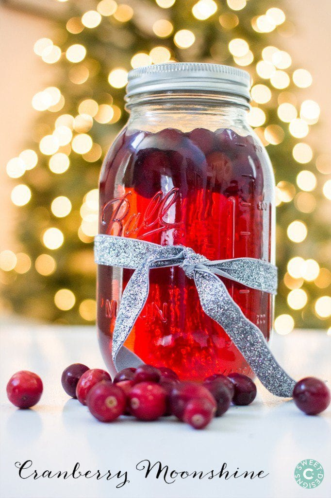 Cranberry Moonshine is a delicious gift you can make and give away! The red color is so gorgeous and you can dress up the mason jar with a glittery bow!