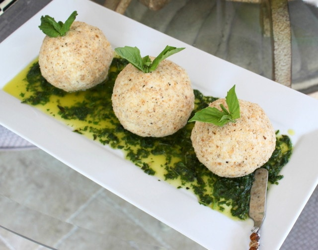Parmesan goat cheese balls on a white tray.