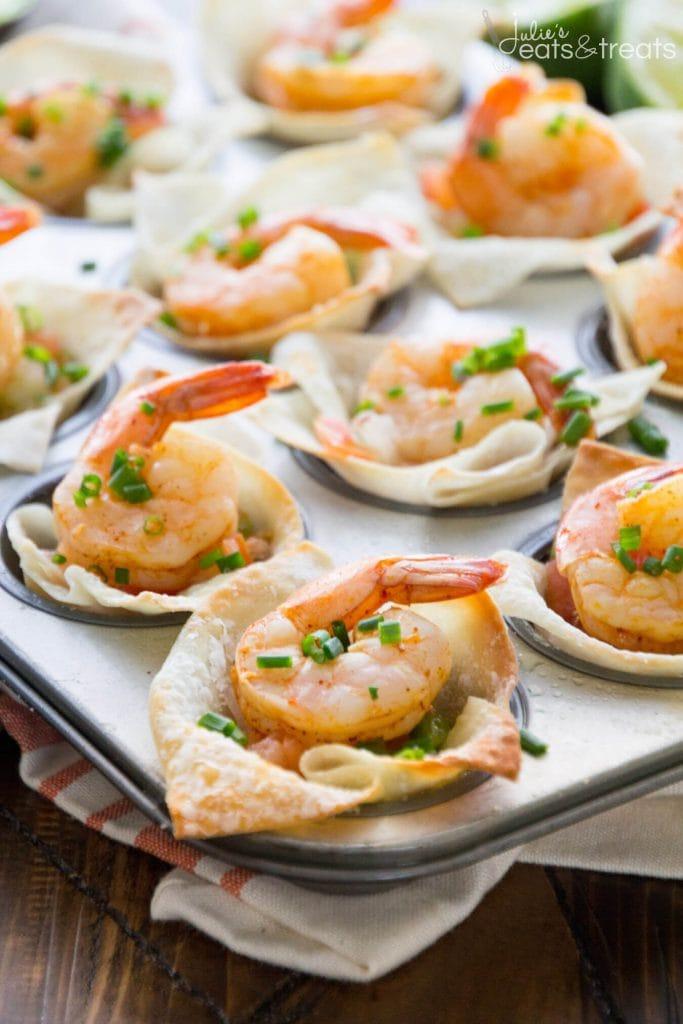 Individual shrimp bites on a baking tray.