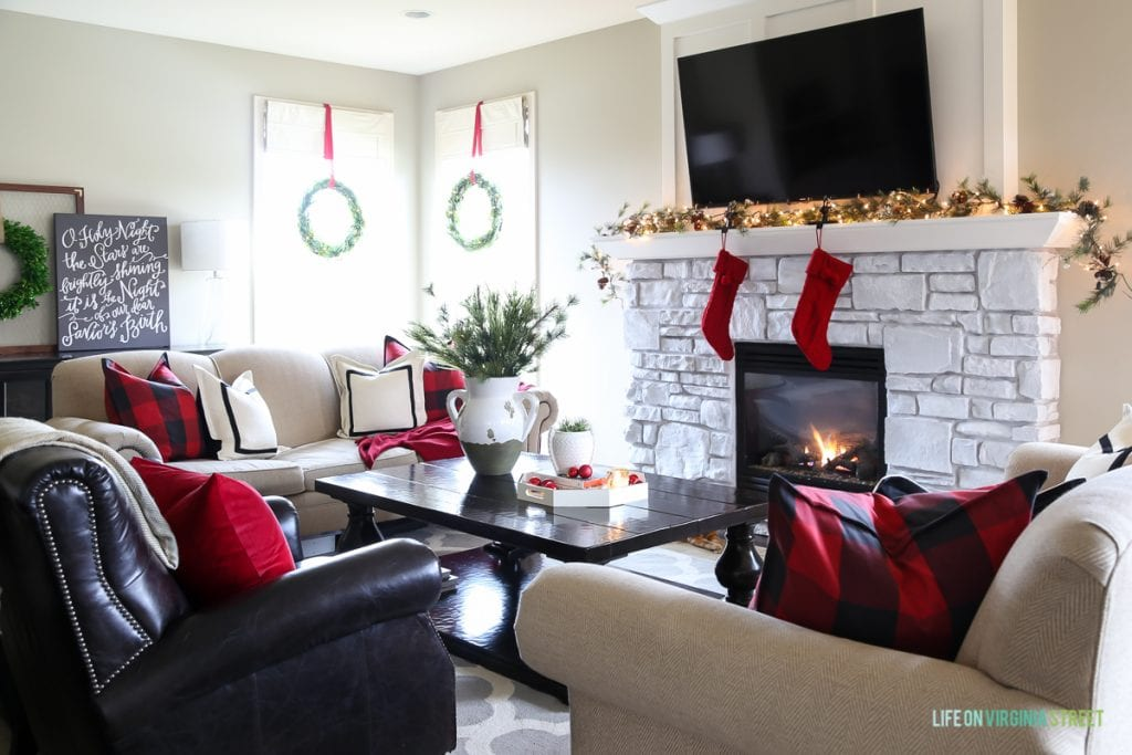 Red and black buffalo check Christmas living room. Love the O Holy Night artwork!