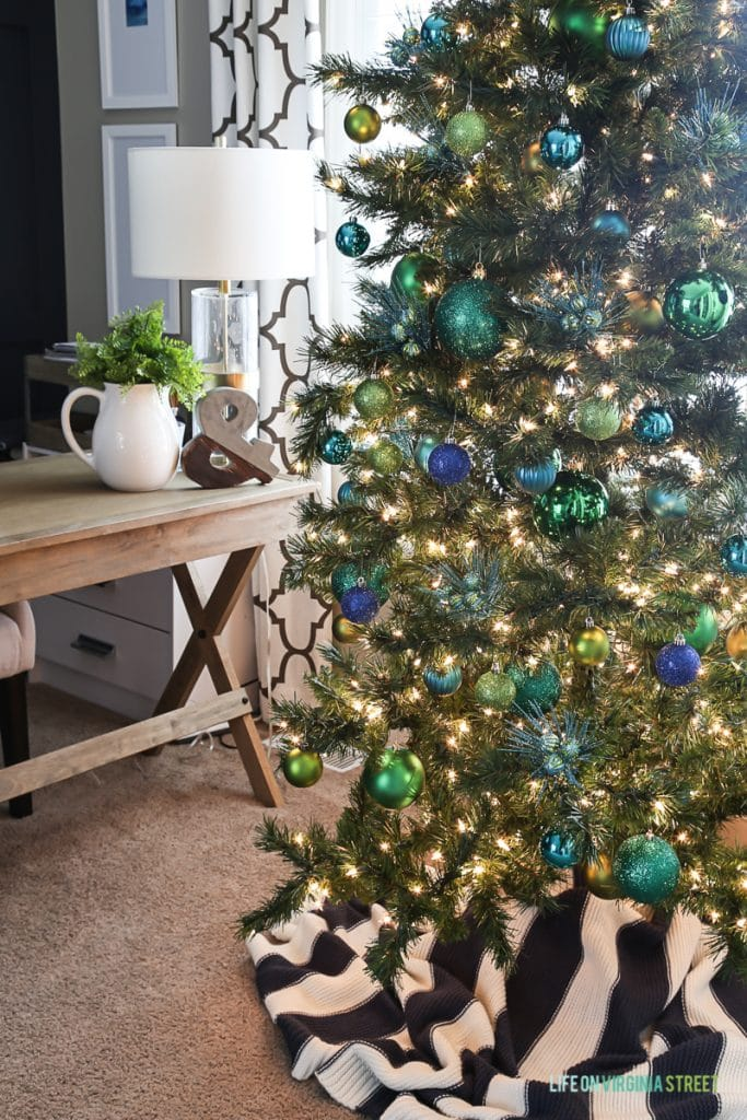 Green and blue ornaments on Christmas tree.