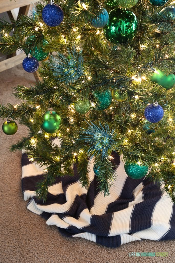 A blue and white skirt around the Christmas tree.