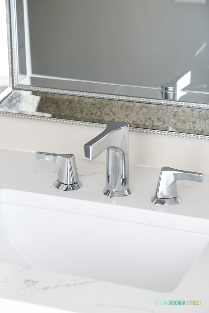Countertops are Daltile One Quartz in the Luminesce color and Delta Faucet Zura faucet that we installed ourselves.