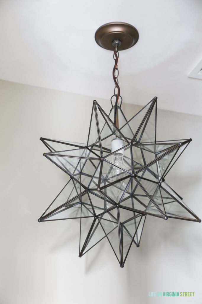 Moravian Star light fixture in a powder bathroom.