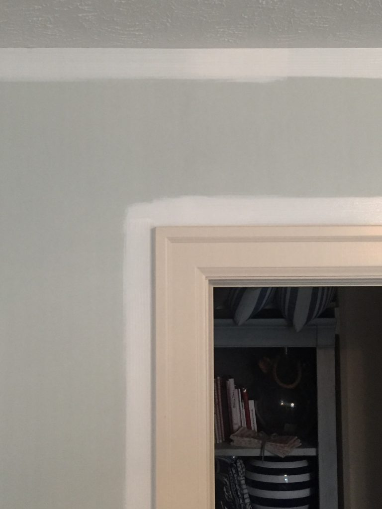 The first parts of painting in progress. You can see from the white paint how not-white our trim is.