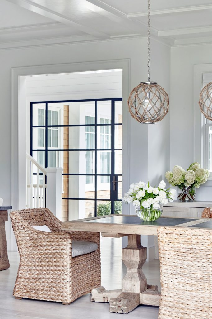 White Dining Room with Black Paned Doors and Windows - Amagansett Beach House by Chango Co. - Photography by Jacob Snavely