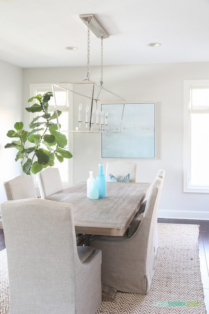 Coastal dining room with natural wood table  linen chairs  fiddle leaf fig  tree. Dining Room Roman Shades and Other Updates   Life On Virginia Street