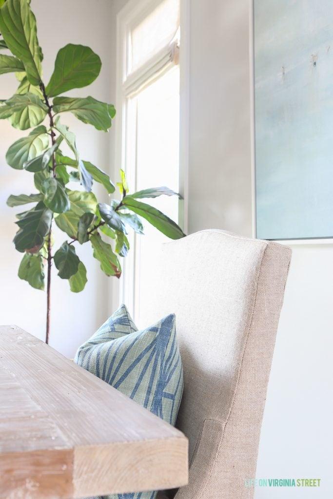 Kelly Wearstler Katana pillow in a coastal dining room.