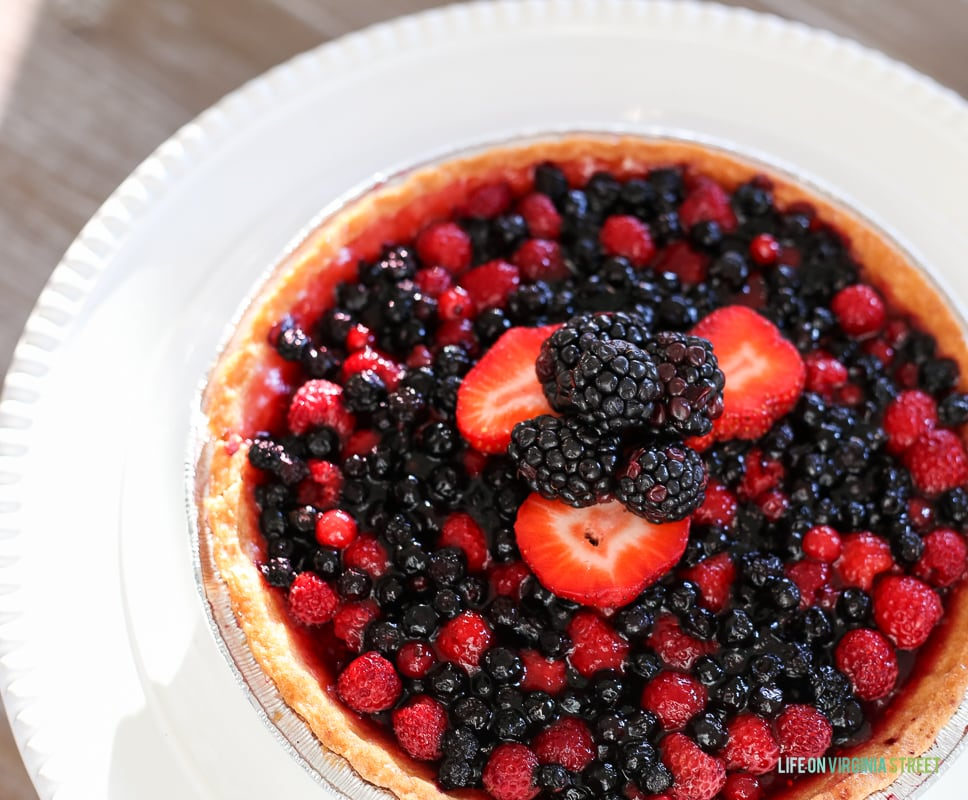 A large berry fruit tart flan on the table