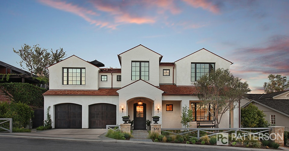 White Brick House with Black Window Frames via Patterson Custom Homes