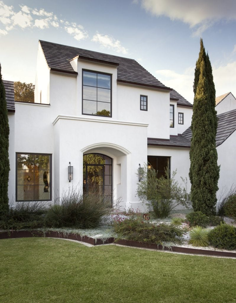 White exterior with black window frames via Ryan Street & Associates