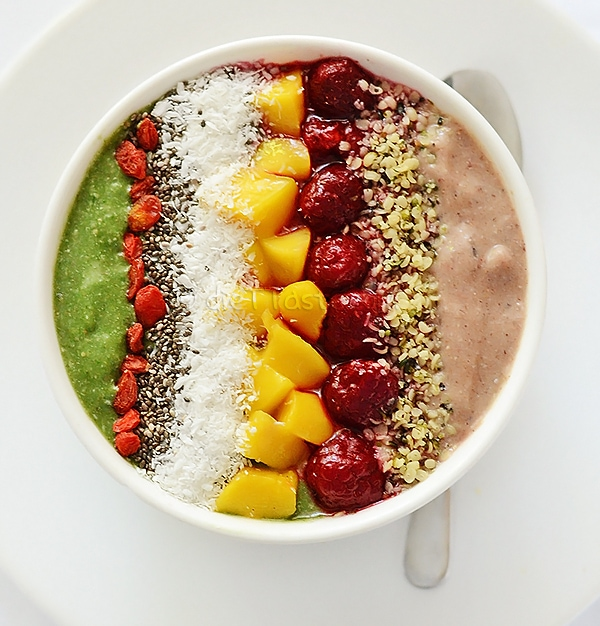 Superfood smoothie bowl on the table with a silver spoon beside it.