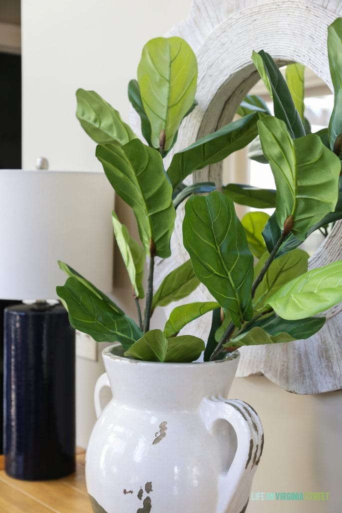 Faux fiddle leaf fig stems in a Pottery Barn urn vase.