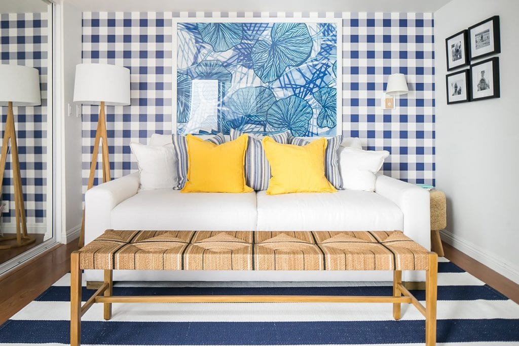 Buffalo check and bright yellow make this small room really pack a punch! It's got a great beach house look.