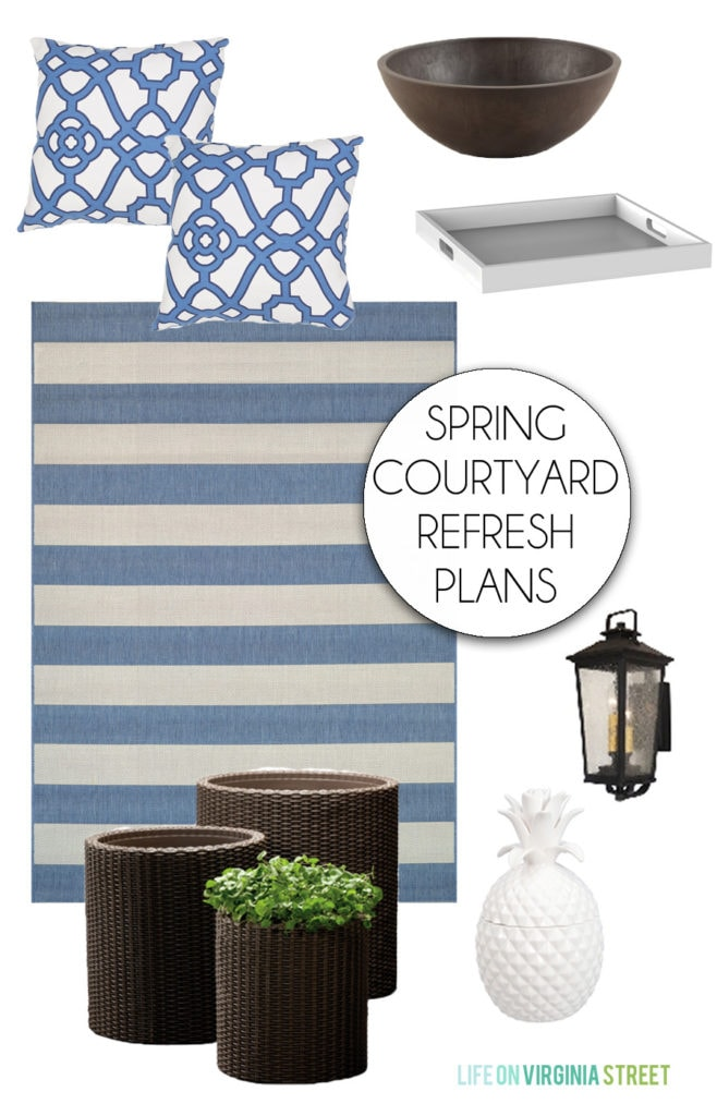 Plans for refreshing an outdoor patio courtyard space. Blue and white striped outdoor rug, blue and white trellis pillows, white ceramic pineapple, woven planters, white serving tray and a planter bowl.