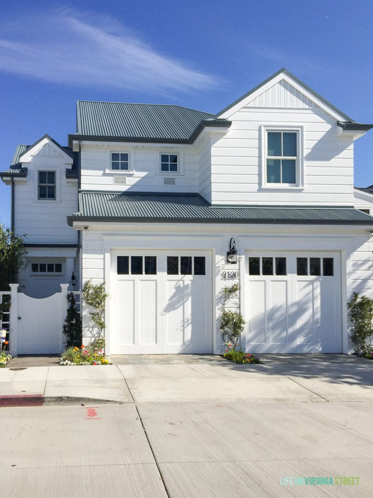 I love the look of this Southern California home, with the all white paint and trim and black roof!