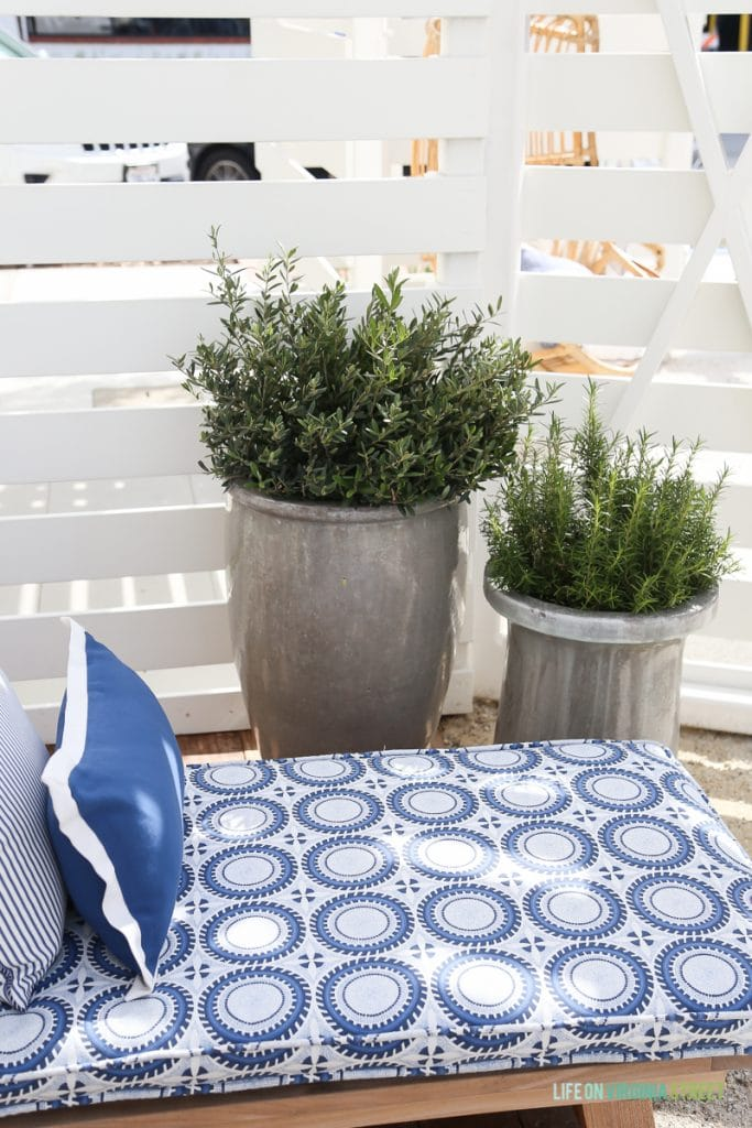 Beautiful silver planters and settee with gorgeous blue and white fabric from Serena & Lily.