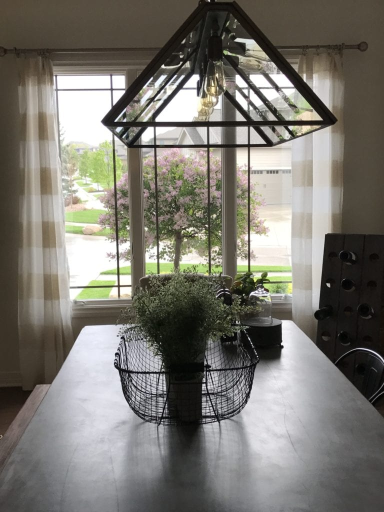 Pottery Barn Greenhouse Light Fixture in a Dining Room
