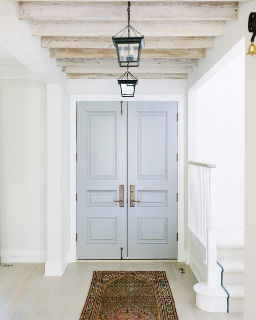 Benjamin Moore Cape May Cobblestone via Kate Marker Interiors. Love the black lanterns, light wood floors and ceiling beams.