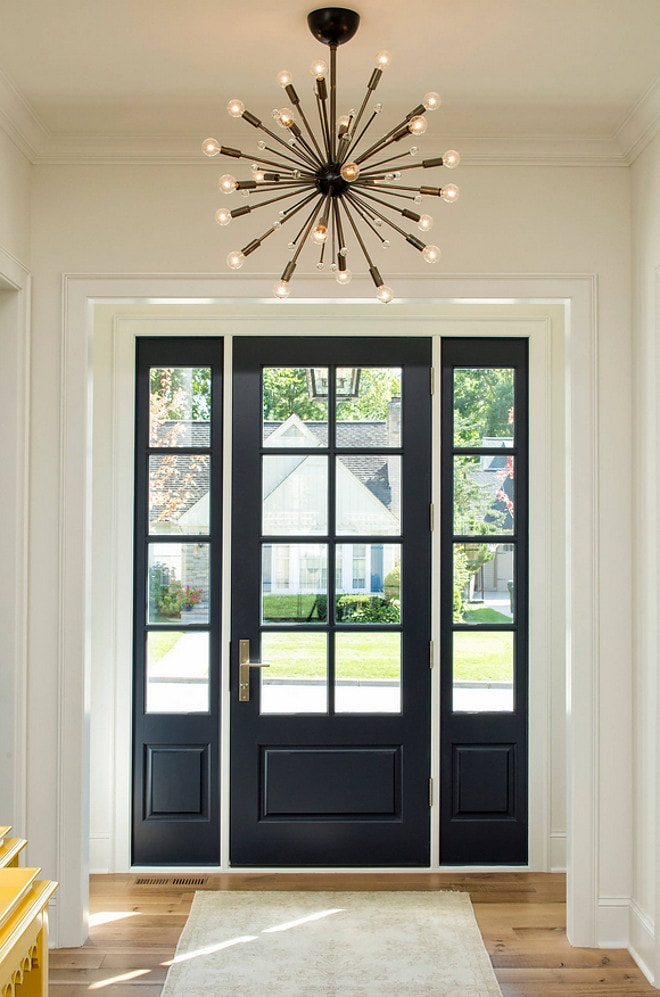 Benjamin Moore Hale Navy interior front door with a large brass light fixture above it.