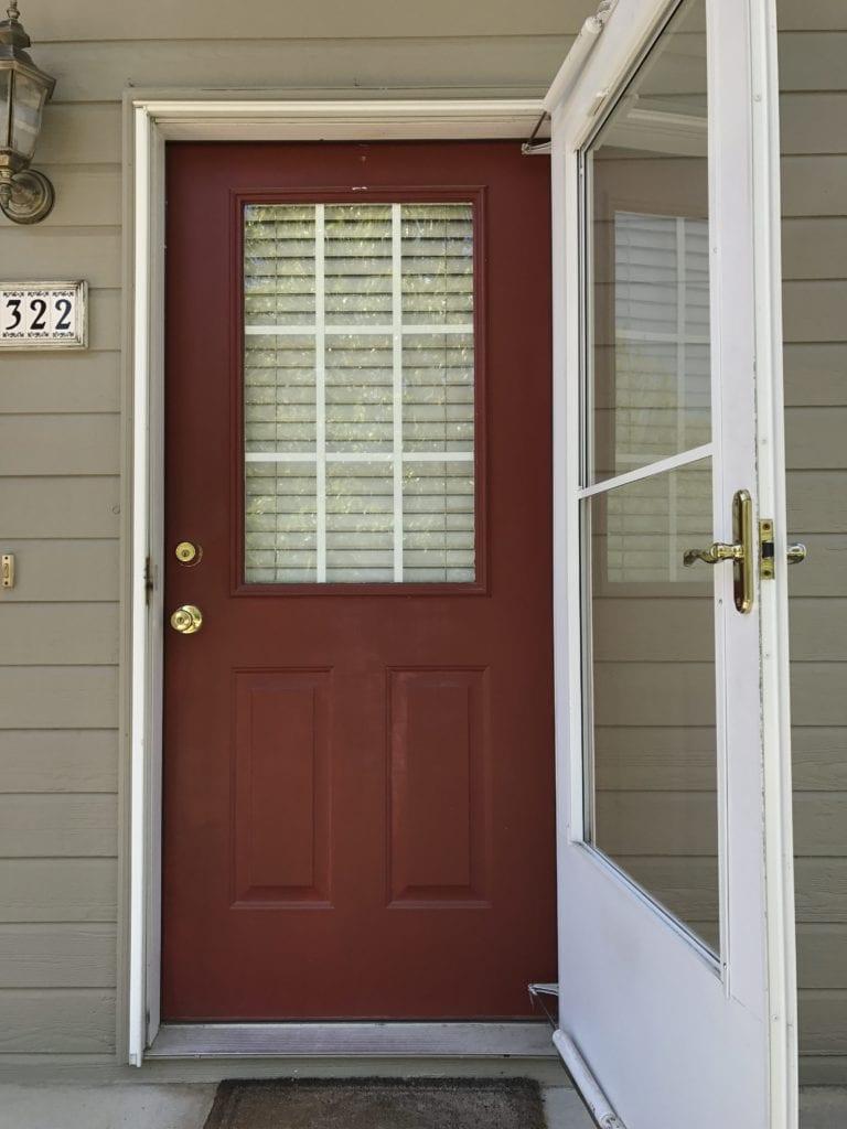 The dark red door of the house.