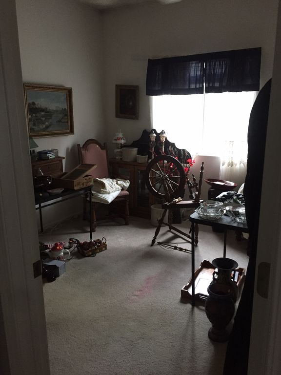A spare room filled with junk items.