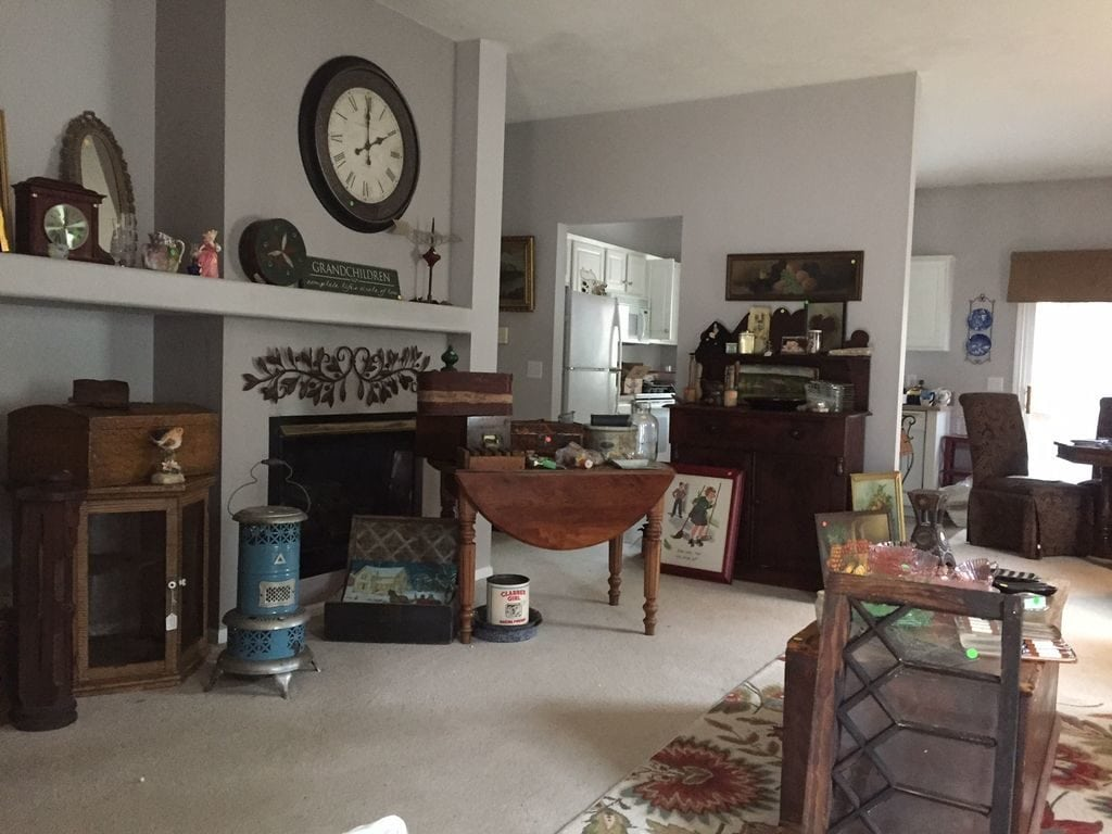 Furniture and items everywhere in a house before the renovation.