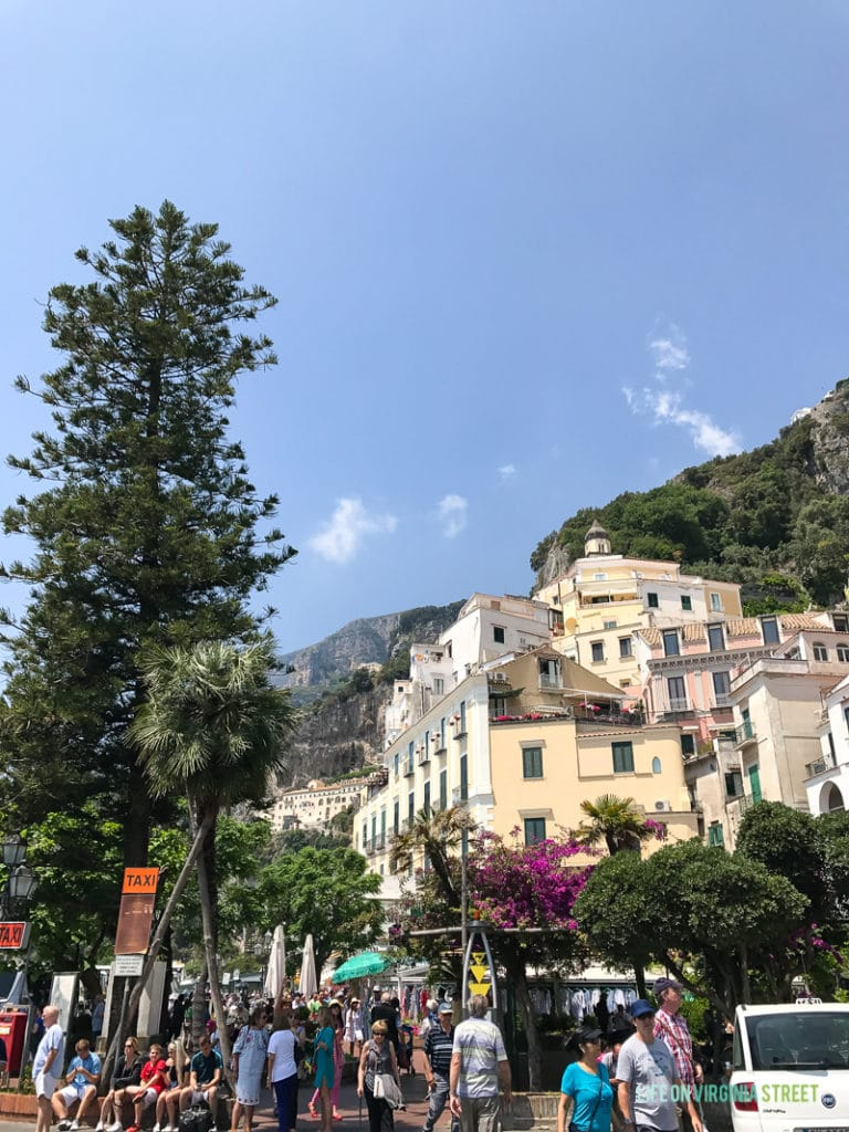 The city of Positano with lots of people in the square.
