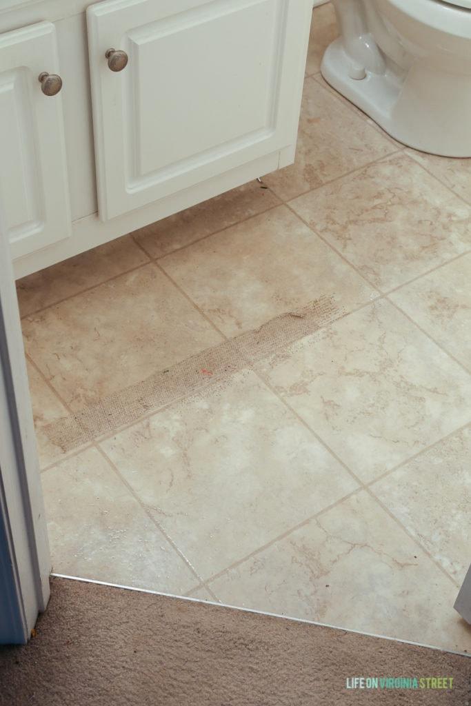 Badly worn linoleum in the bathroom.
