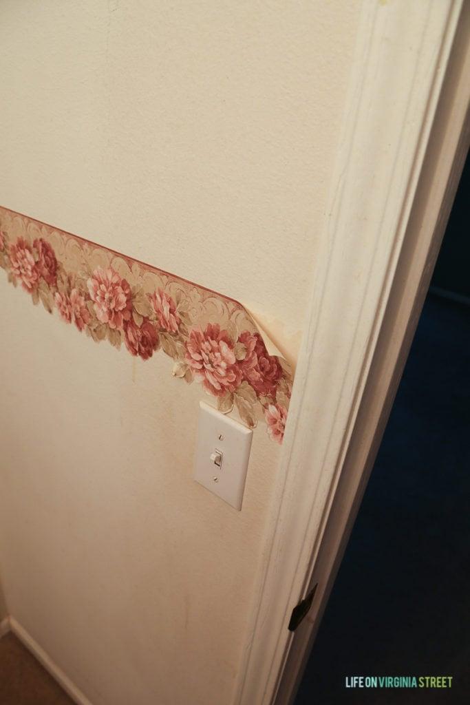 Peeling floral wallpaper in the bedroom.