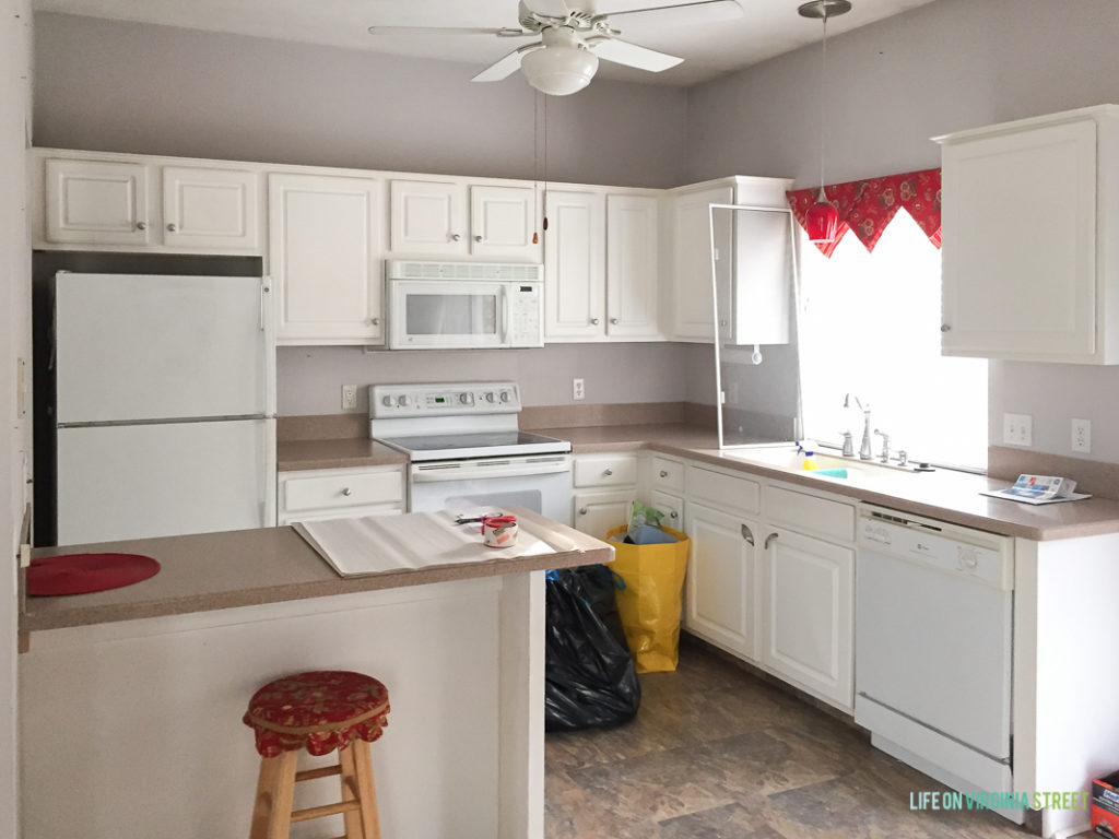 White cupboards, in the kitchen.