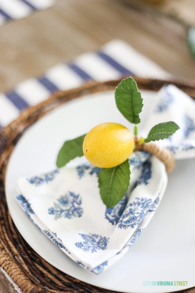 Lemon napkin rings around blue and white napkins.