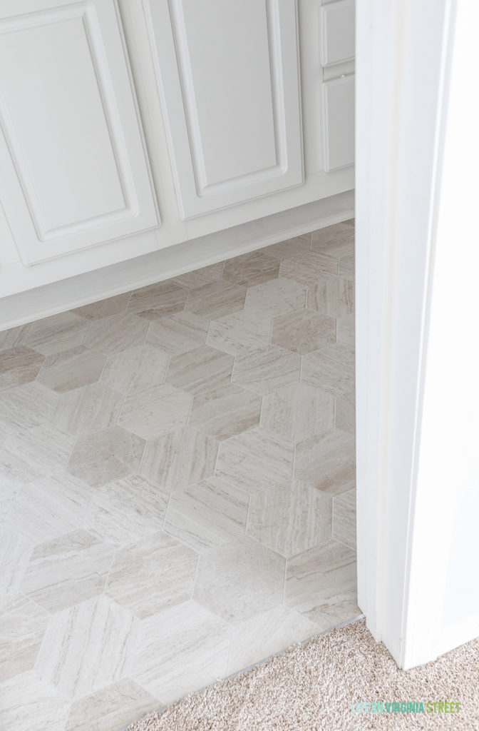 Up close look at the bathroom floor makeover is using Mannington Luxury Vinyl in Hive Pollen.