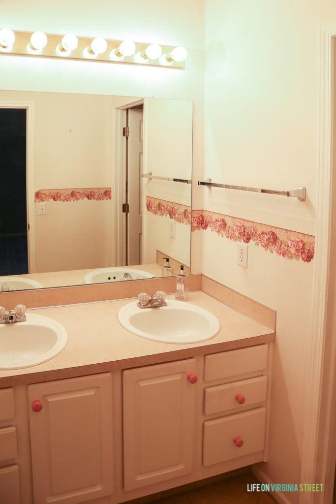 A pinky peachy bathroom.