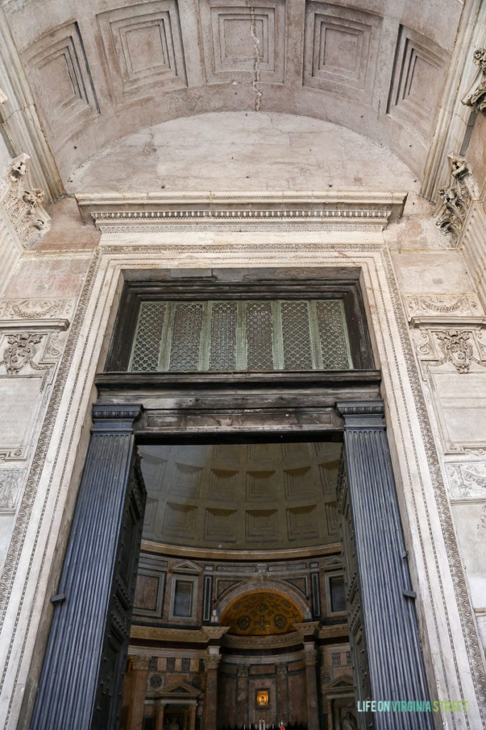 The large doorway with ornate trim in the Parthenon.