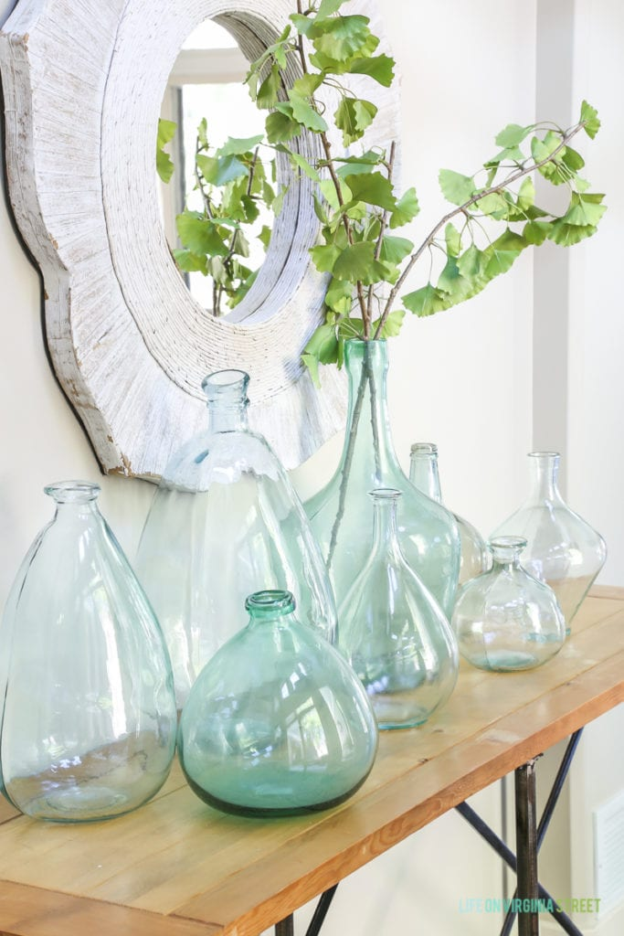 This collection of recycled glass vases is perfect for a coastal vibe. Love the ginkgo greenery as well!