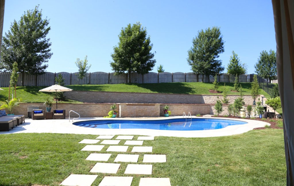 Here's our beautiful backyard pool before we finished the landscaping.