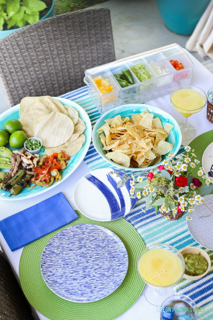 Blue, white and green tablescape with a taco bar. Great party idea!