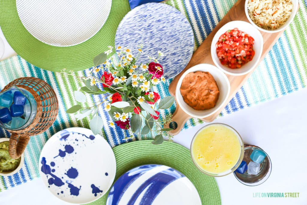 Blue and white plates, plus flowers on the table.