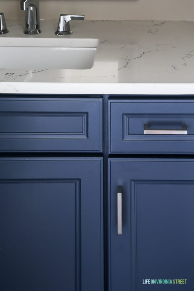 Thermofoil painted cabinets with Benjamin Moore Hale Navy paint.