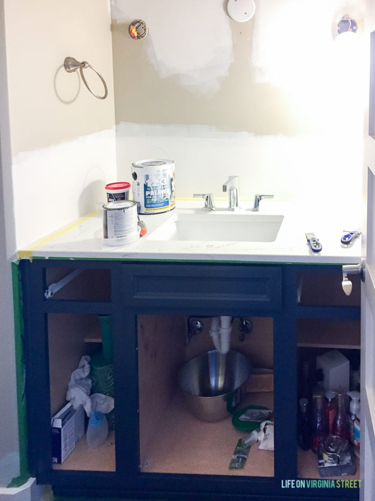 Painting the rest of the cabinet in the bathroom.