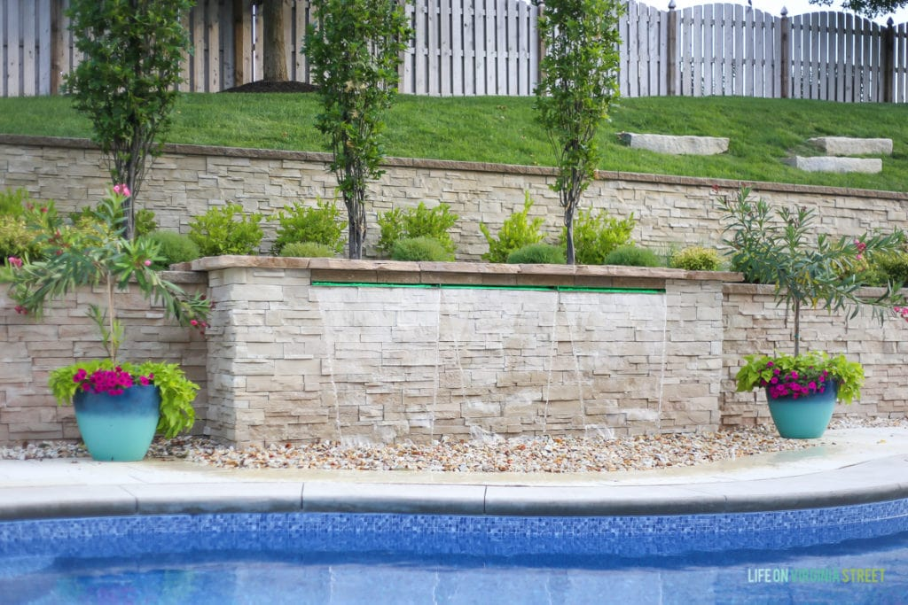 Here's a great shot of our waterfall feature that sits on the far side of our backyard pool. It looks great with our landscaping and I love the waterfall sound!