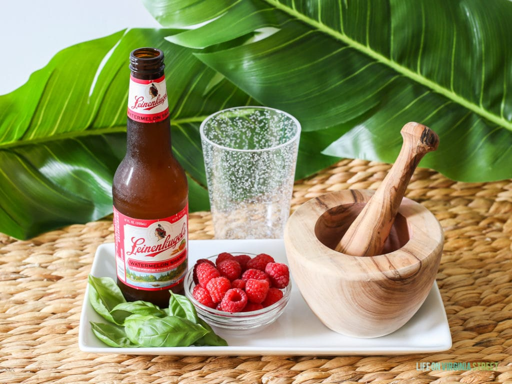 A delicious beer cocktail featuring Leinenkugel's Watermelon Shandy, Raspberries and Basil. The perfect poolside drink!