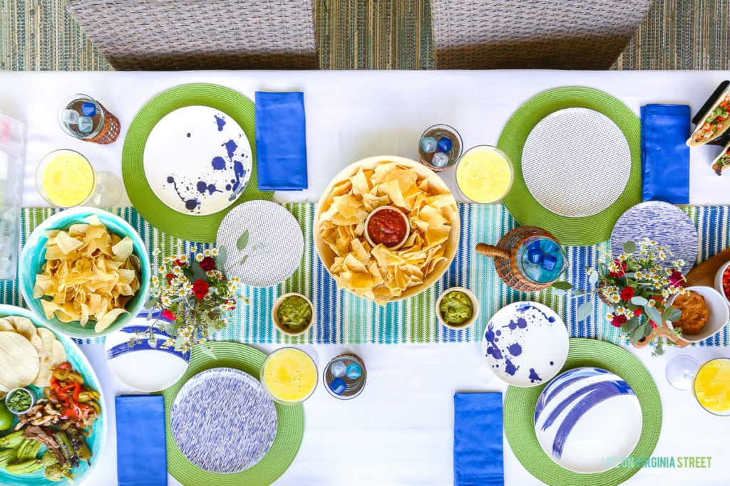 Grilled taco fixings on a blue, white and green tablescape. Striped table runner and green woven placemats. Includes fresh margarita recipe.