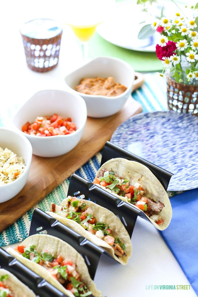 Grilled taco fixings on a blue, white and green tablescape. Great party idea!
