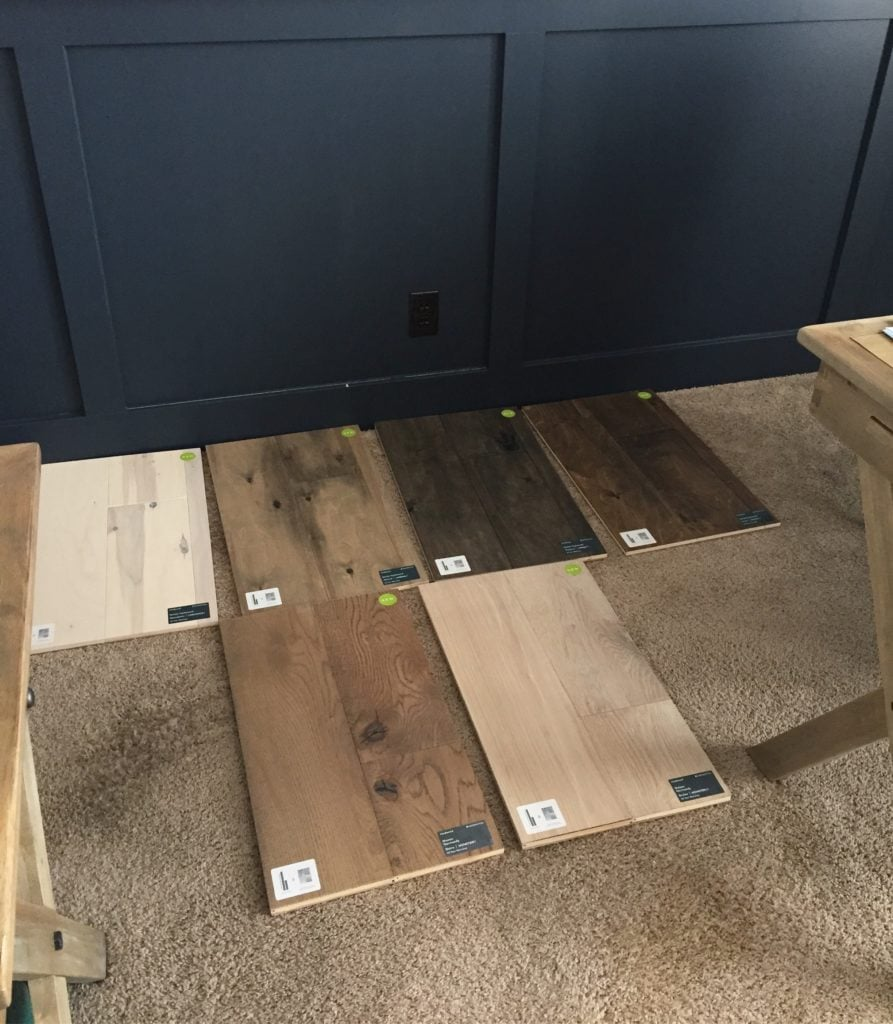 Testing the Mannington hardwood floor options against our board and batten navy wall.