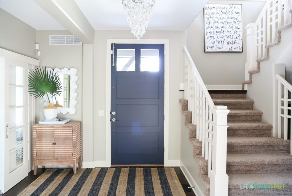 A simple entryway update my painted interior door makeover life coastal style entryway update with crystal teardrop chandelier navy blue jute striped rug striped save i painted the door planetlyrics Image collections