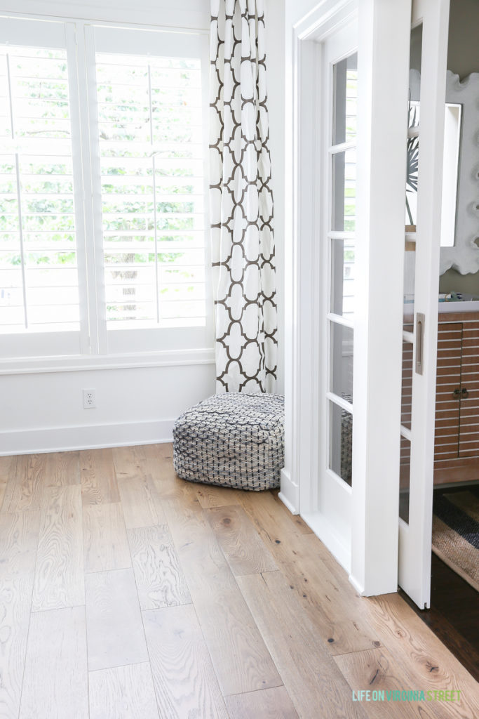Home office with Benjamin Moore Simply White walls and trim with Mannington white oak Maison Normandy Bistro hardwood floors. Curtain fabric is Windsor Smith Riad in Clove.
