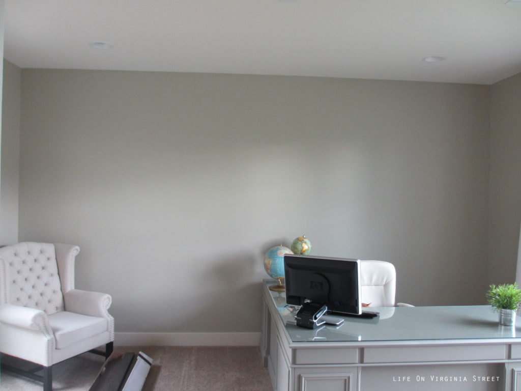 Lightened up walls in our office using Behr's Castle Path paint.